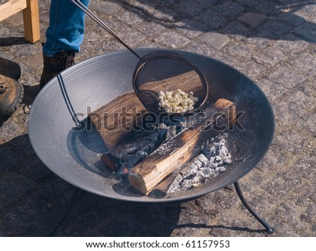 Fire pit with burning logs ready for country style cooking popcorn