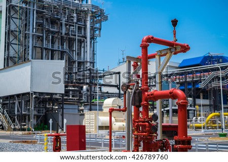 Fire protection piping against power plant background - stock photo