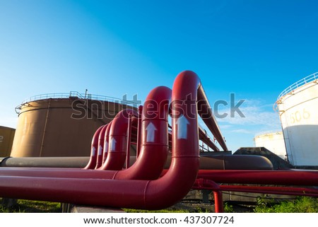 Fire protection piping and fuel oil storage tank in power plant  - stock photo