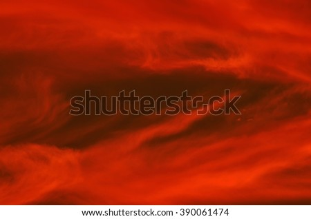 Fire red clouds at sunset - stock photo