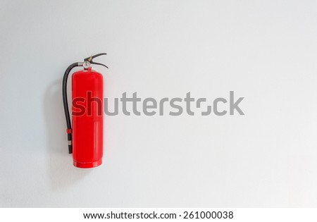 Fire safety on white cement wall background - stock photo