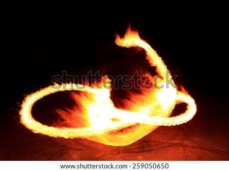 Fire show flaming trails, background. - stock photo