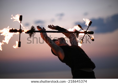 Fire show with gymnastic elements - stock photo