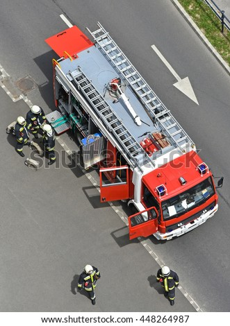 Fire truck and firefighters from aerial view