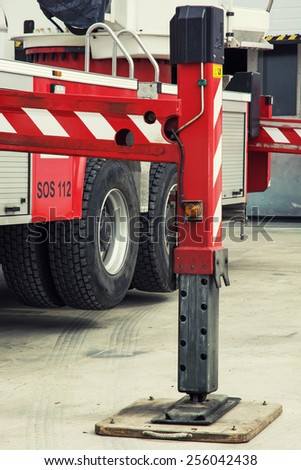 Fire truck outrigger stabilizing legs extended. - stock photo