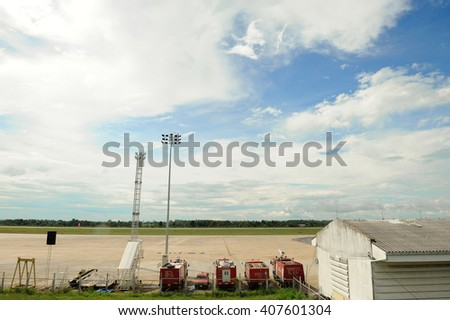 fire truck parked on airport runway. - stock photo