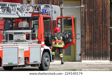 fire truck with a firefighter during an emergency - stock photo