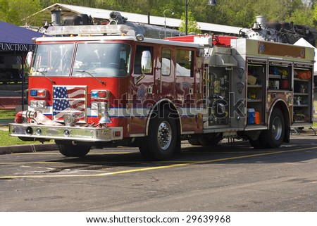 Fire truck with flag in grill