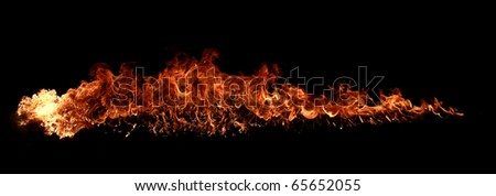 Fire wall on black background - stock photo