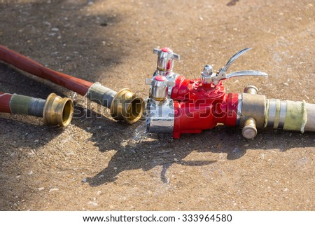 Fire Water hose connector on the ground - stock photo