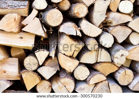 Fire wood background texture, firewood in a pile - stock photo