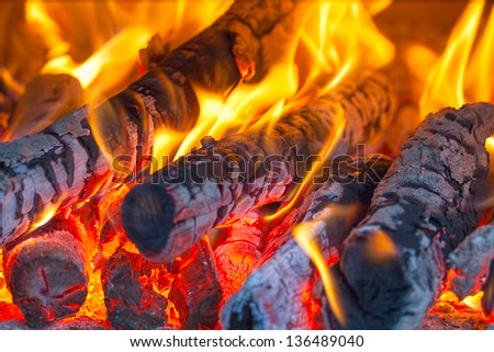 Fire wood burns in a fireplace - stock photo