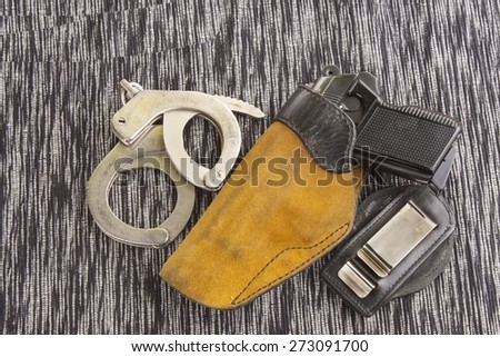 firearm lying on the table, metal police handcuffs ( CZ vzor 70, cal. 7,65mm ) - stock photo