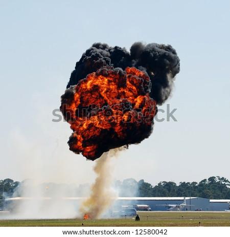 Fireball explosion above airfield - stock photo