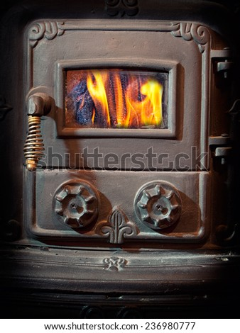 Firebox door of a retro wood burning stove.