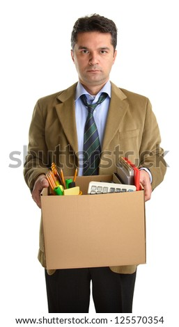 Fired businessman in a suit carrying a box of personal items isolated on white background - stock photo