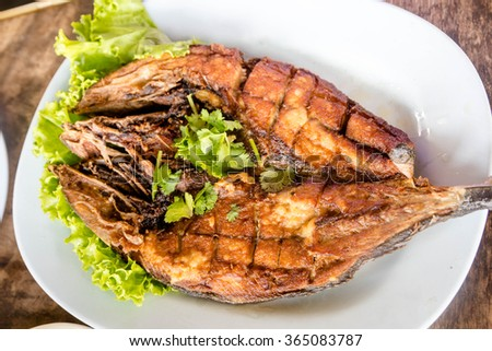 fired fish with fish sauce for thai food