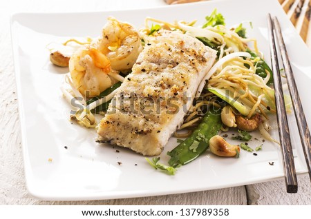fired fish with noodles and vegetables - stock photo
