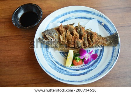 fired fish with sauce delicious Japanese food - stock photo