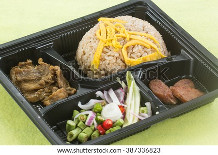 Fired Rice with shrimp paste include mango, egg,pork,dried shrimp,and red onions in Box set / Thai style food
