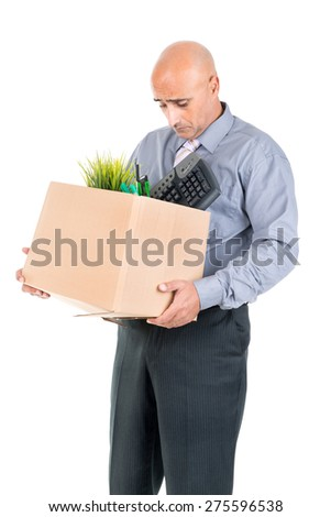 Fired worker with cardboard box with his belongings - stock photo