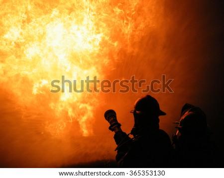 Firefighter Battling Blaze - stock photo