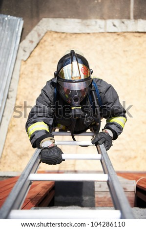 Firefighter climb on fire metal stairs