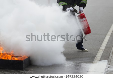 Firefighter extinguishes a training fire . - stock photo