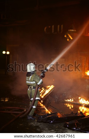 Firefighter fighting a fire - stock photo