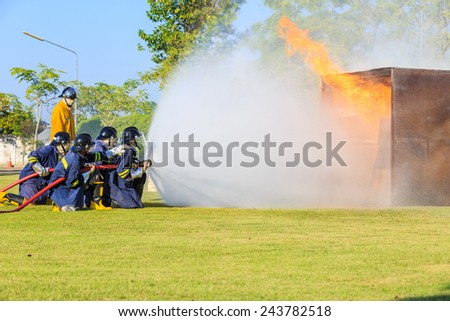 Firefighter fighting for fire attack training  - stock photo