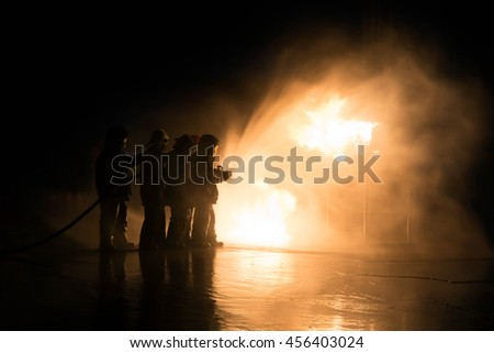 Firefighter Fireman Attack Fire with High Pressure Water