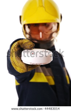 Firefighter holding fire alarm (focus on alarm) isolated on white - stock photo