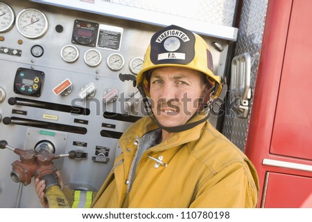 Firefighter holding hose - stock photo