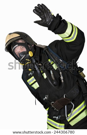 Firefighter in self contained breathing apparatus hand shows gesture OK - stock photo