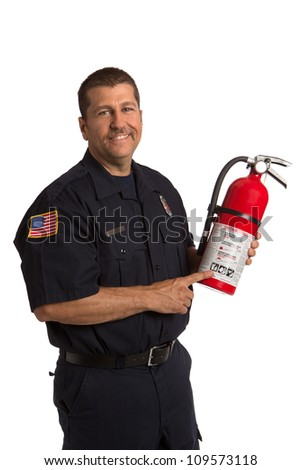 Firefighter in uniform holding fire extinguisher pointing to instruction on isolated white background - stock photo