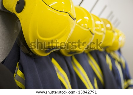 Firefighter's coats and helmets hanging up in a fire station