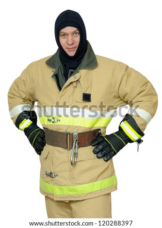 Firefighter stands arms akimbo. Isolated on white background