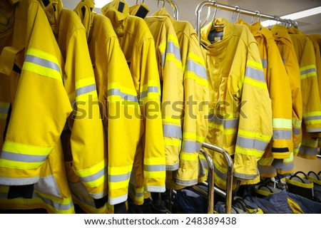 firefighter suit and equipment ready for operation. - stock photo