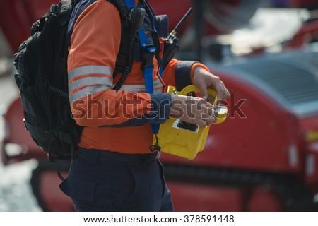 firefighter training to remote anti bio hazard machine - stock photo