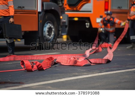 firefighter training with fire hose - stock photo