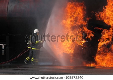 Firefighter trying to put out a fire in Sweden. - stock photo