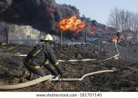Firefighter using hose - stock photo