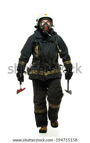 Firefighter with axes and wearing oxygen mask isolated on white  - stock photo
