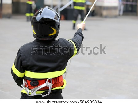 firefighter with hardhat during rescue operations with a long rope