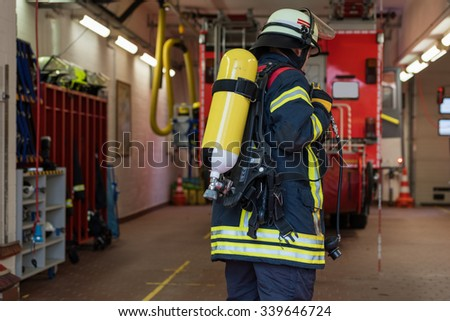 Firefighter with oxygen cylinder in the fire department