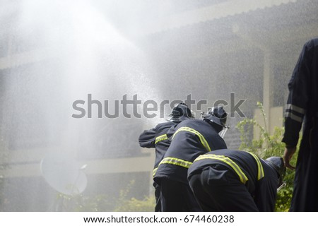 Firefighters against fire in the big building.save and rescue teams concept.