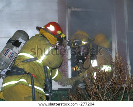 firefighters at window - stock photo