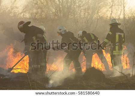 firefighters battle a wildfire in spring