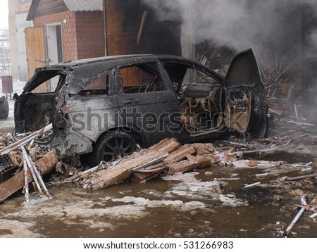 Firefighters extinguish a car;