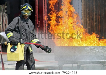 Firefighters extinguish a fire during training